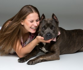Smiling Girl with Gray Stafford Dog Stock Photo
