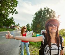 Smiling girl hitchhiking Stock Photo