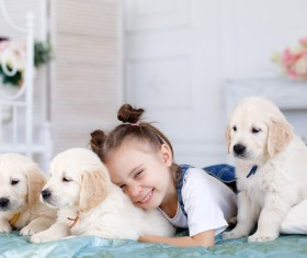 Smiling little girl with puppy Stock Photo