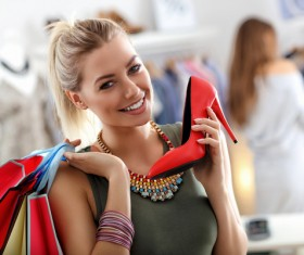 Smiling woman buying red high heels HD picture