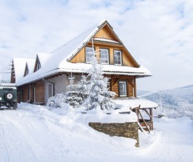 Snow covered villas with cars Stock Photo