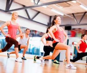 Sports hall where beautiful women doing aerobics Stock Photo