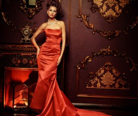 Standing in front of the fireplace red dress woman Stock Photo 03