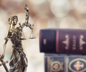 Statue of the goddess of justice and legal books Stock Photo 01