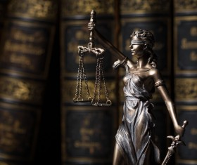 Statue of the goddess of justice and legal books Stock Photo 02