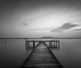 Sunset at the wooden dock black and white photo