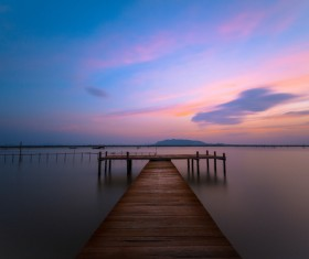 Sunset in the wooden dock Stock Photo 02