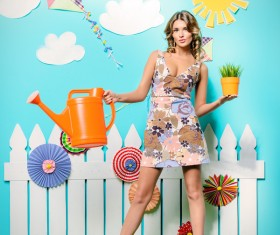 Take the watering can and potted woman Stock Photo 01