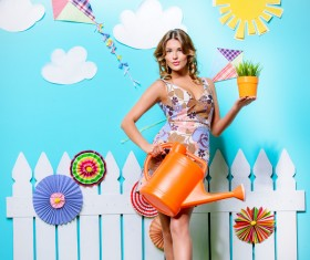 Take the watering can and potted woman Stock Photo 02