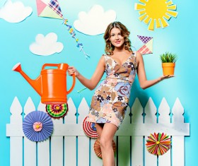 Take the watering can and potted woman Stock Photo 03