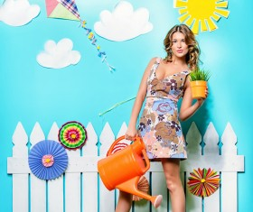 Take the watering can and potted woman Stock Photo 04