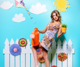 Take the watering can and potted woman Stock Photo 05