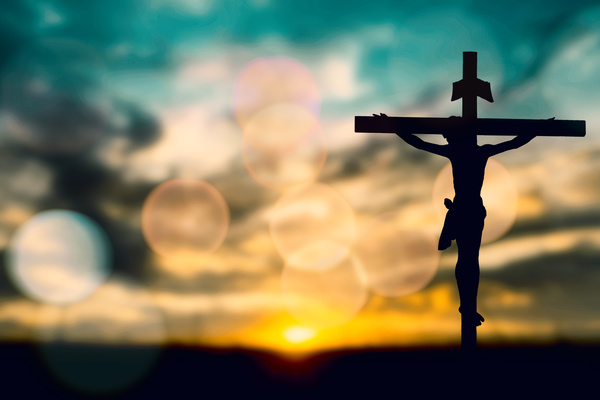 silhouette of jesus with cross over sunset concept for religion
