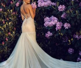 The bride wearing a luxury wedding dress