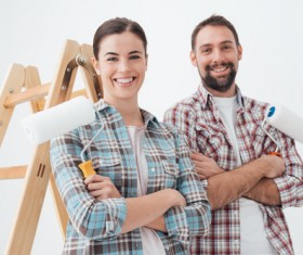 The couple holding roller brush Stock Photo