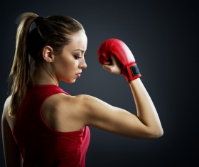The female boxer showing muscle Stock Photo
