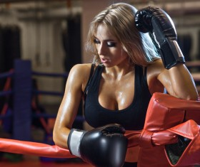 The female boxer who rests in the ring Stock Photo