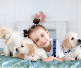 The little girl with a head pillow on a dog Stock Photo