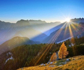 The sun between the mountains Stock Photo