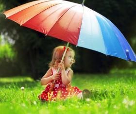 Umbrella little girl on the grass Stock Photo