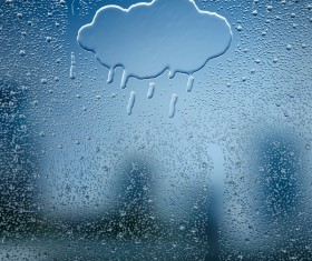 Water droplets and clouds on glass windows Stock Photo