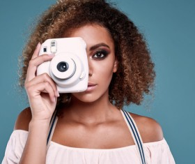 With a camera to take pictures of girl Stock Photo