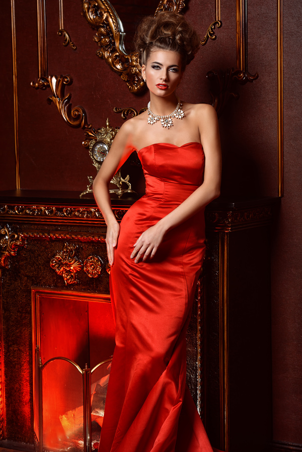 Woman Wearing A Red Dress With Jewelry Necklace Stock Photo