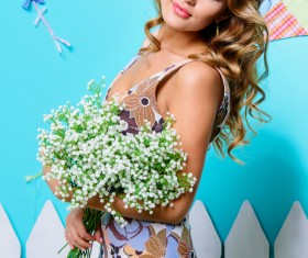 blonde woman with white bouquets Stock Photo