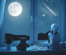 little girl looked at the night sky Stock Photo