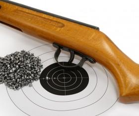 Air gun bullets and target paper Stock Photo