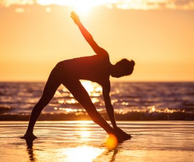 Backlight shooting sunrise beach practicing yoga woman Stock Photo 01