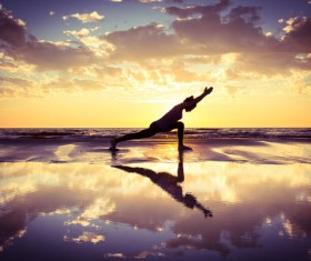 Backlight shooting sunrise beach practicing yoga woman Stock Photo 02