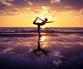 Backlight shooting sunrise beach practicing yoga woman Stock Photo 03