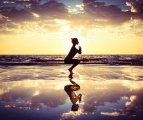 Backlight shooting sunrise beach practicing yoga woman Stock Photo 04
