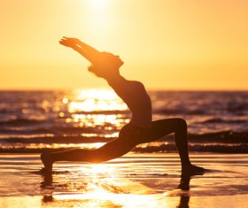 Backlight shooting sunrise beach practicing yoga woman Stock Photo 05