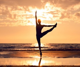 Backlight shooting sunrise beach practicing yoga woman Stock Photo 06