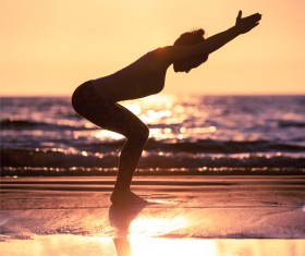 Backlight shooting sunrise beach practicing yoga woman Stock Photo 07