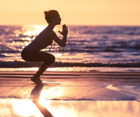 Backlight shooting sunrise beach practicing yoga woman Stock Photo 08