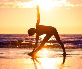 Backlight shooting sunrise beach practicing yoga woman Stock Photo 11