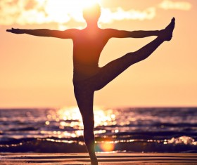Backlight shooting sunrise beach practicing yoga woman Stock Photo 12