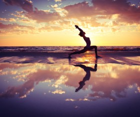 Backlight shooting sunrise beach practicing yoga woman Stock Photo 14