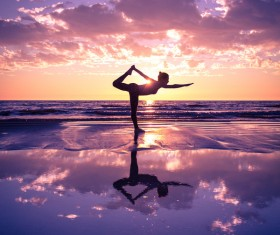 Backlight shooting sunrise beach practicing yoga woman Stock Photo 15