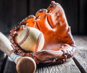 Baseball glove and a baseball bat Stock Photo
