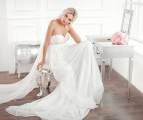 Beautiful bride sitting in front of the dressing table Stock Photo