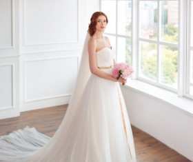Beautiful bride standing at the window Stock Photo 01