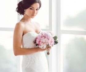 Beautiful bride standing at the window Stock Photo 03