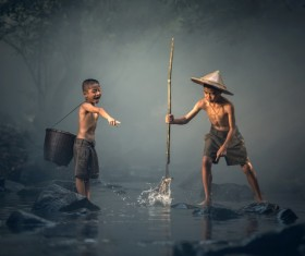Cambodian children catch fish Stock Photo
