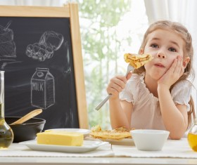 Children who eat delicious pancakes Stock Photo
