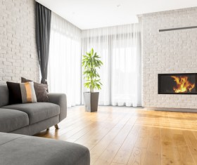 Corner sofa with large plant fireplace living room Stock Photo 01
