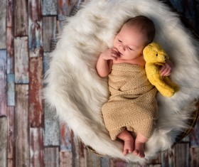 Cute baby holding a teddy bear HD picture